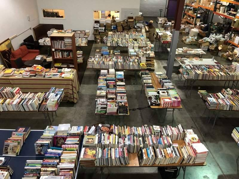 Sondra Bernstein and helpers treat fire survivors to an amazing selection of cookbooks to replace the ones they lost. (COURTESY PHOTO)