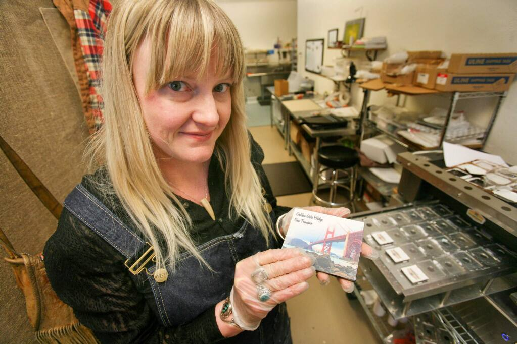 Rae Vittorelli, Owner and founder of Cocoagraph, with one of her photo chocolates in her store in Petaluma on Monday, February 23, 2015. (SCOTT MANCHESTER/ARGUS-COURIER STAFF)