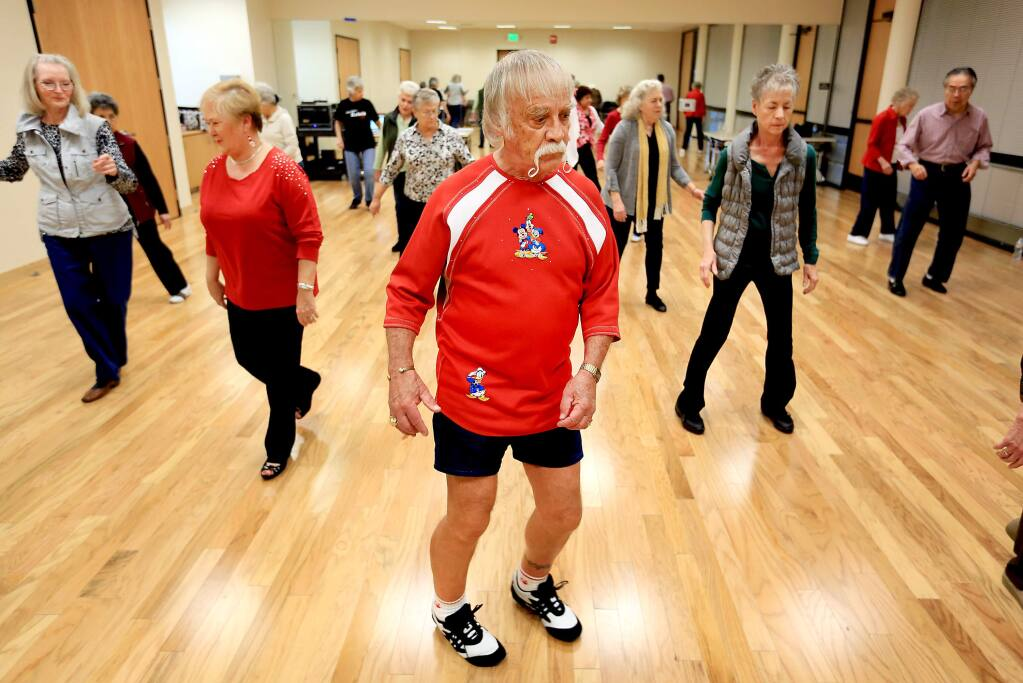 Sonoma County is discussing ways to assist the growing senior citizens committee on a number of fronts including transportation and activities, such as this line dance class at the Person Senior Center in Santa Rosa. (KENT PORTER / Press Democrat, 2014)