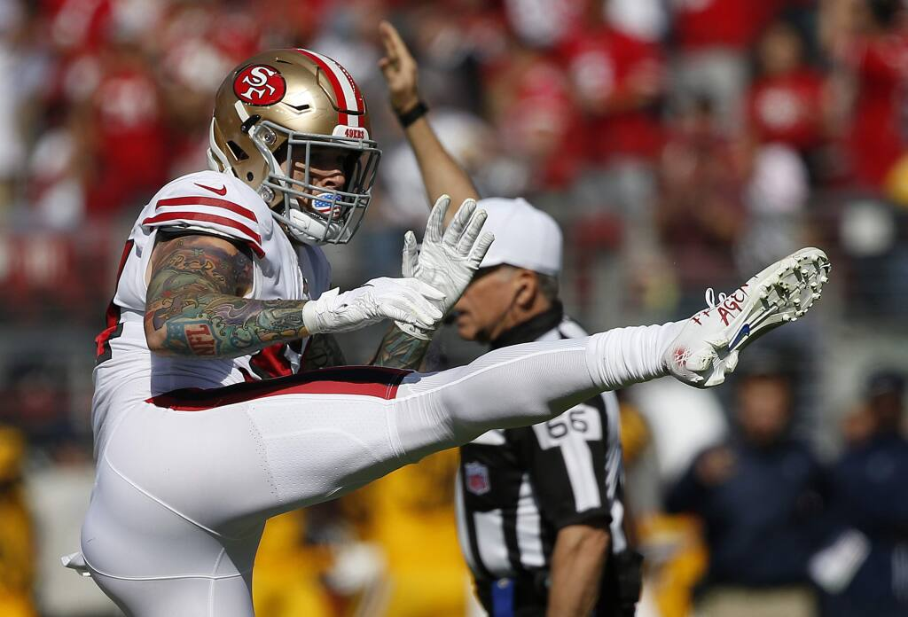 San Francisco 49ers defensive end Cassius Marsh celebrates after sacking Los Angeles Rams quarterback Jared Goff during the first half in Santa Clara, Sunday, Oct. 21, 2018. (AP Photo/Josie Lepe)