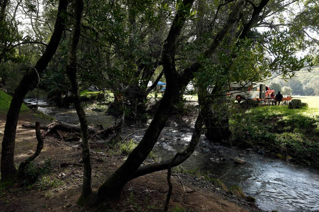 Campers have breakfast alongside Sonoma Creek at Sugarloaf Ridge State Park in Kenwood, California on Saturday, March 19, 2016. (Alvin Jornada / The Press Democrat)