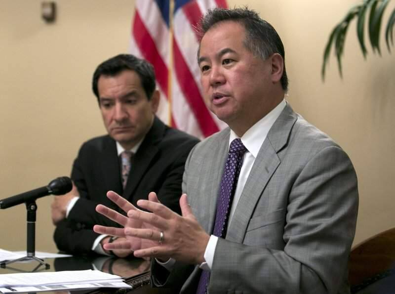 In this June 13, 2017, file photo, Assemblyman Phil Ting, D-San Francisco, right, discusses the state budget in Sacramento. In 2016, Gov. Jerry Brown vetoed a bill by Ting that would have expanded the list of those who can seek gun violence restraining orders to include, among others, employees of high schools and colleges. The school shooting in Parkland, Fla., Feb. 14, that killed at least 17 people, has revived the debate about red flag laws. Ting said he plans to reintroduce the bill. (AP Photo/Rich Pedroncelli,File)