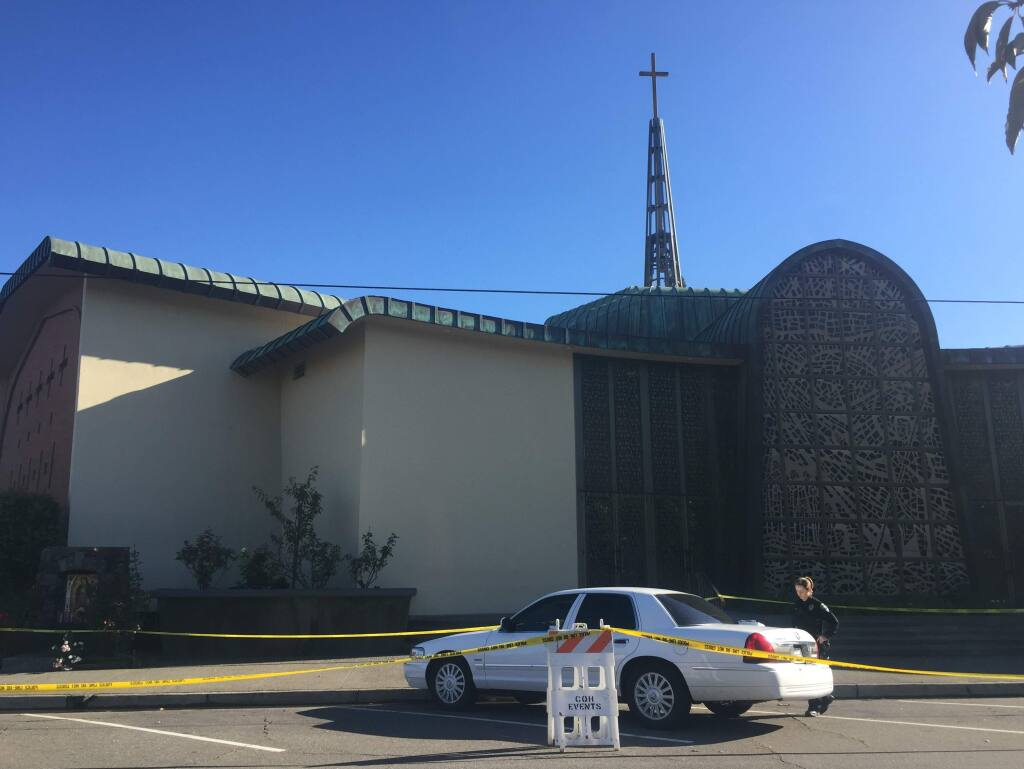 Police cordoned off St. John's Catholic Church on Matheson Street in Healdsburg as they investigate the death of a child on Sunday, Nov. 20, 2016. (BETH SCHLANKER/ PD)