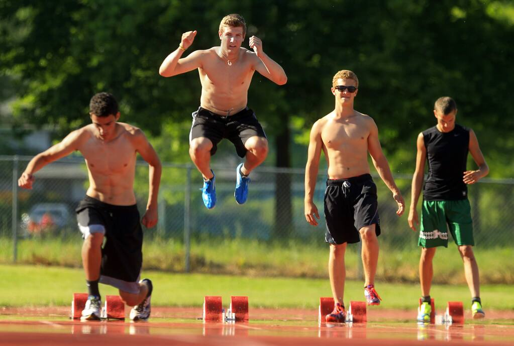 Maria Carrillo hurdler Alex Netherda, jumping, says that if he qualifies, he will skip his graduation to attend the state track finals. Also pictured are, left to right, Isaiah Smith, Spencer Netherda and Jordan Rosado. (JOHN BURGESS / The Press Democrat)