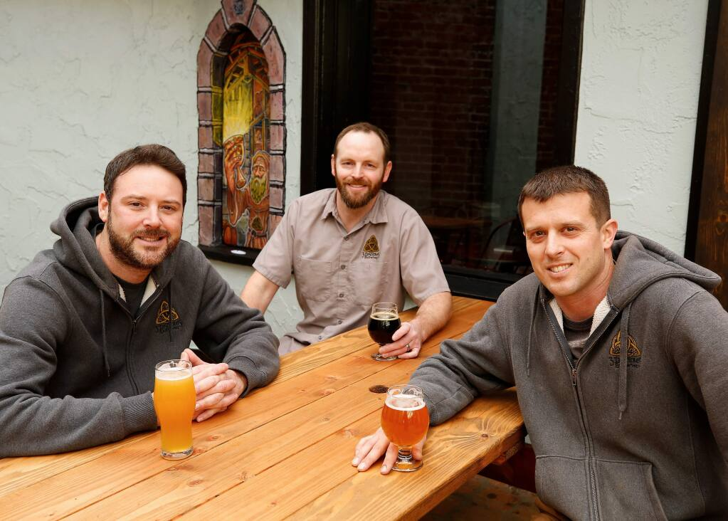 The co-founders of 3 Disciples Brewing, from left, James Claus, Matt Penpraze, and Luke Melo pose for a portrait at 3 Disciples Brewing in Santa Rosa, California, on Wednesday, February 6, 2019. (Alvin Jornada / The Press Democrat)