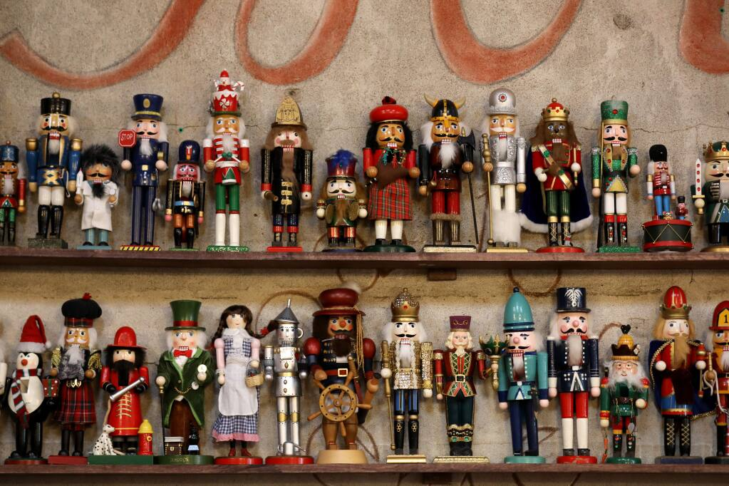 A huge variety of nutcrackers decorate the shelves at Costeaux's French Bakery in Healdsburg on Tuesday, November 26, 2019. (BETH SCHLANKER/ The Press Democrat)