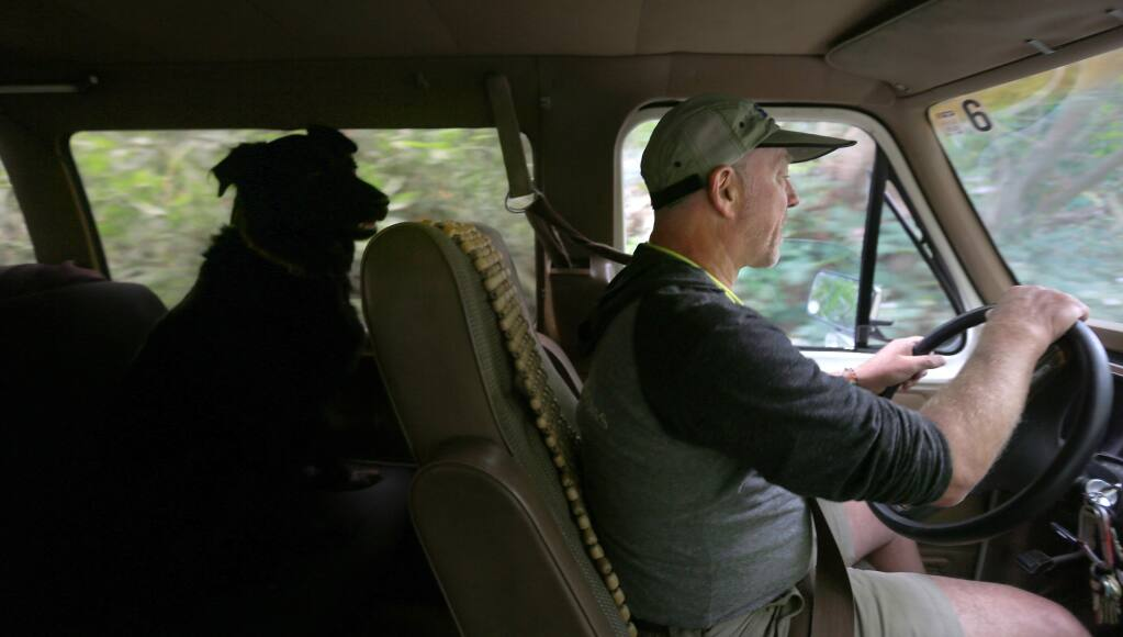 Larry Laba, president of SOAR (Somewhere On A River) in Healdsburg and his dog Indy, head to the river to give a safety speech to customers preparing to take a self guided Russian River float trip, Wednesday May 20, 2015 in Healdsburg. (Kent Porter / Press Democrat) 2015