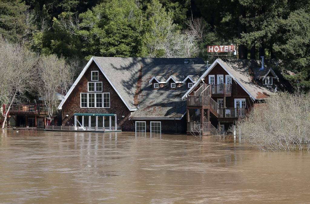 Water from the Russian River surrounds Highland Dell Lodge in Monte Rio on Thursday, February 28, 2019. (Christopher Chung / The Press Democrat)