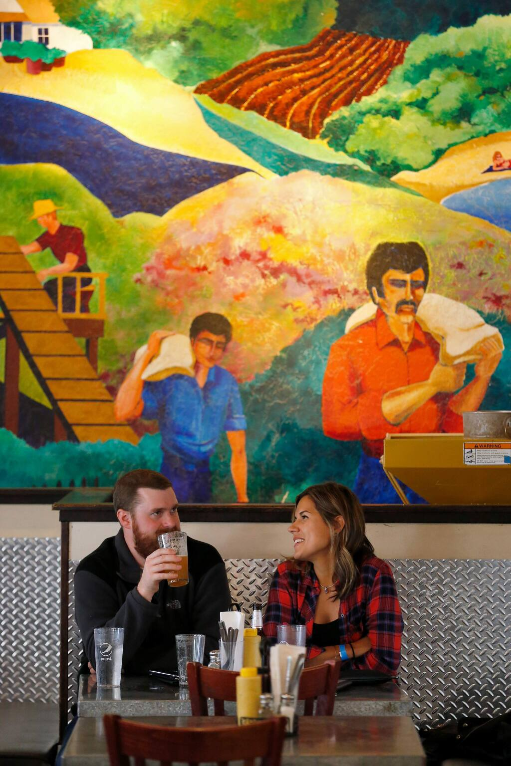 Noah Schmidt and Emily McClelland of Santa Rosa enjoy some drinks at Bear Republic Brewing Company's taproom in Healdsburg, California, on Saturday, October 19, 2019. Bear Republic Brewing Company recently announced the closing of their original brewpub in Healdsburg, after 25 years of operation. (Alvin Jornada / The Press Democrat)