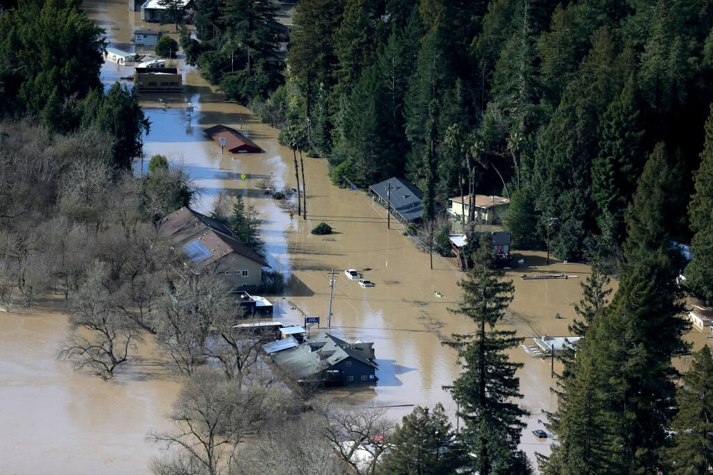A view of River Road in Guerneville submerged by floodwaters on Feb. 2. (BETH SCHLANKER / The Press Democrat)