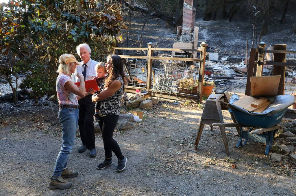 Homeowner Richard Sievers, center, Elaine Pacioretty, left, and her daughter Vanessa Vann, and grandson Malakai Vann Smith, 2, talk front of the home they shared along Chalk Hill Road, near Windsor, on Tuesday, November 5, 2019. The home was destroyed in the Kincade fire.(Christopher Chung/ The Press Democrat)
