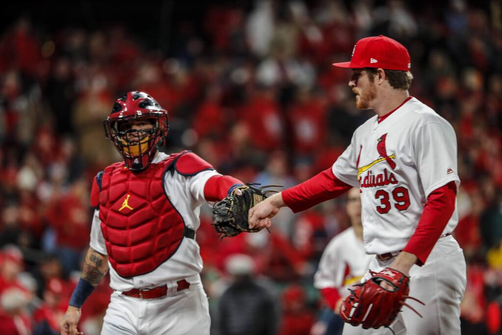 St. Louis Cardinals starting pitcher Miles Mikolas is congratulated by catcher Yadier Molina after the first inning of Game 1 of the National League Championship Series against the Washington Nationals Friday, Oct. 11, 2019, in St. Louis. (AP Photo/Jeff Roberson)