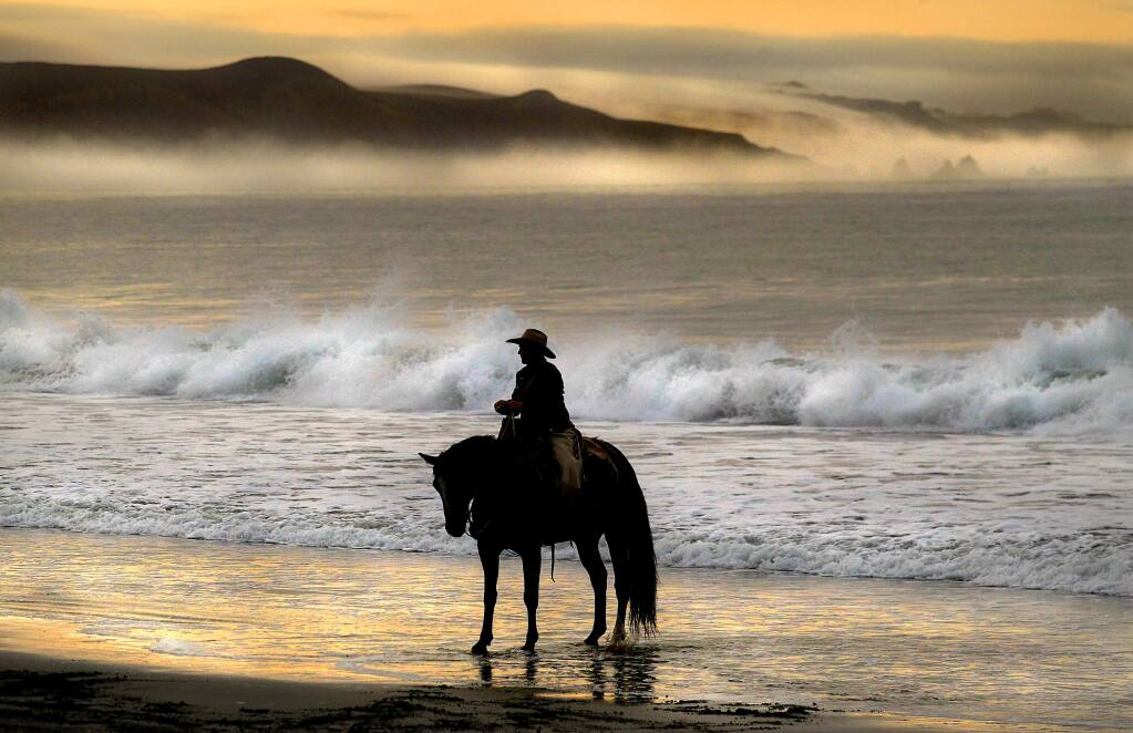 Eddyann Filipini of Battle Mountain, Nevada, waits in the surf at Doran Beach in Bodega Bay for the start of a horse relay ride across the United States to protest grazing rights in her state.