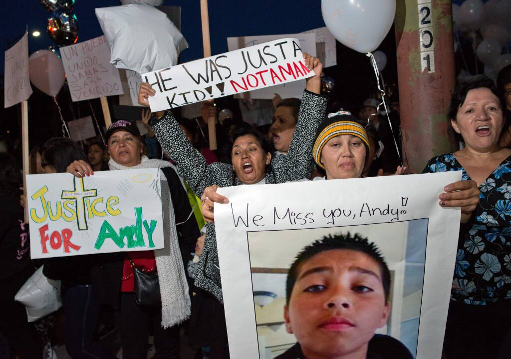 Sujey Lopez, second from right, stands with a large group of protesters in front of Santa Rosa City Hall, at the corner of Santa Rosa Avenue and 1st Street, during a protest march and vigil for Andy Lopez in Santa Rosa, Calif., on Oct. 24, 2013, two days after the 13-year-old was shot and killed by a Sonoma County sheriff's deputy. (ALVIN JORNADA/ PD)