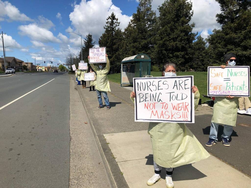 Petaluma Valley Hospital Nurses staged a picket outside the hospital on March 25 to draw attention to the lack of safety equipment. The equipment they are wearing is expired. MATT BROWN/ARGUS-COURIER STAFF