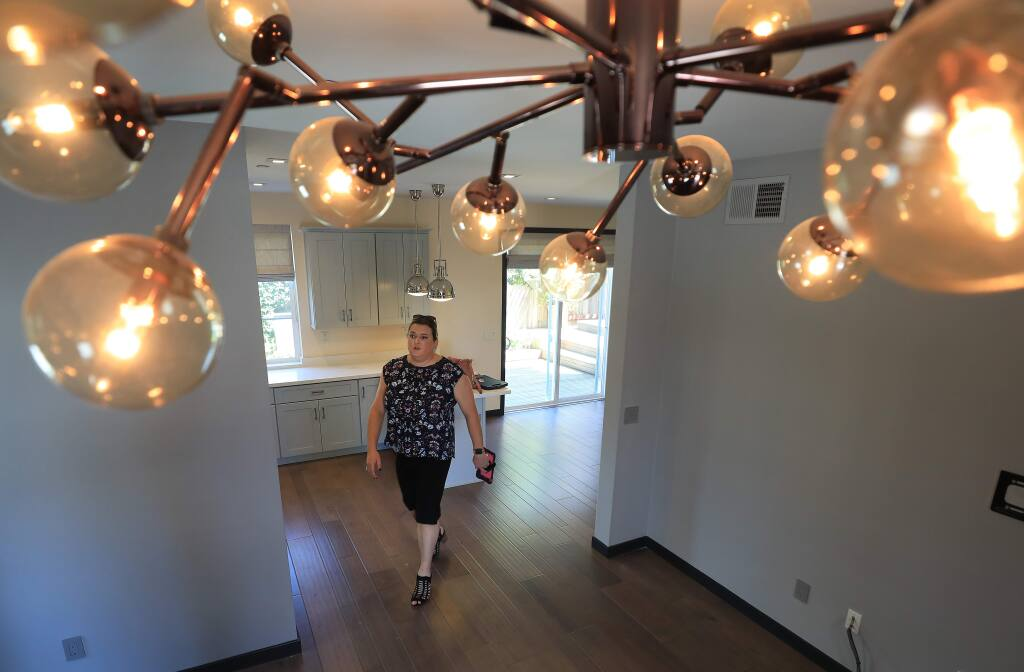 DeDe's Rentals & Management property manager Jenny Rihl, makes a walk through of a rental home in Santa Rosa, Wednesday, Aug. 21, 2019. (Kent Porter / The Press Democrat) 2019