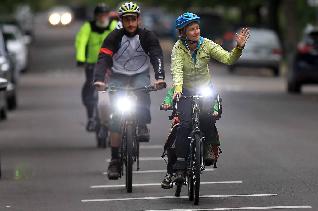 Members of the Sonoma County Bicycle Coalition participated in the Ride of Silence, a national movement to honor those killed or injured while cycling on public roadways. (KETN PORTER / The Press Democrat, 2018)