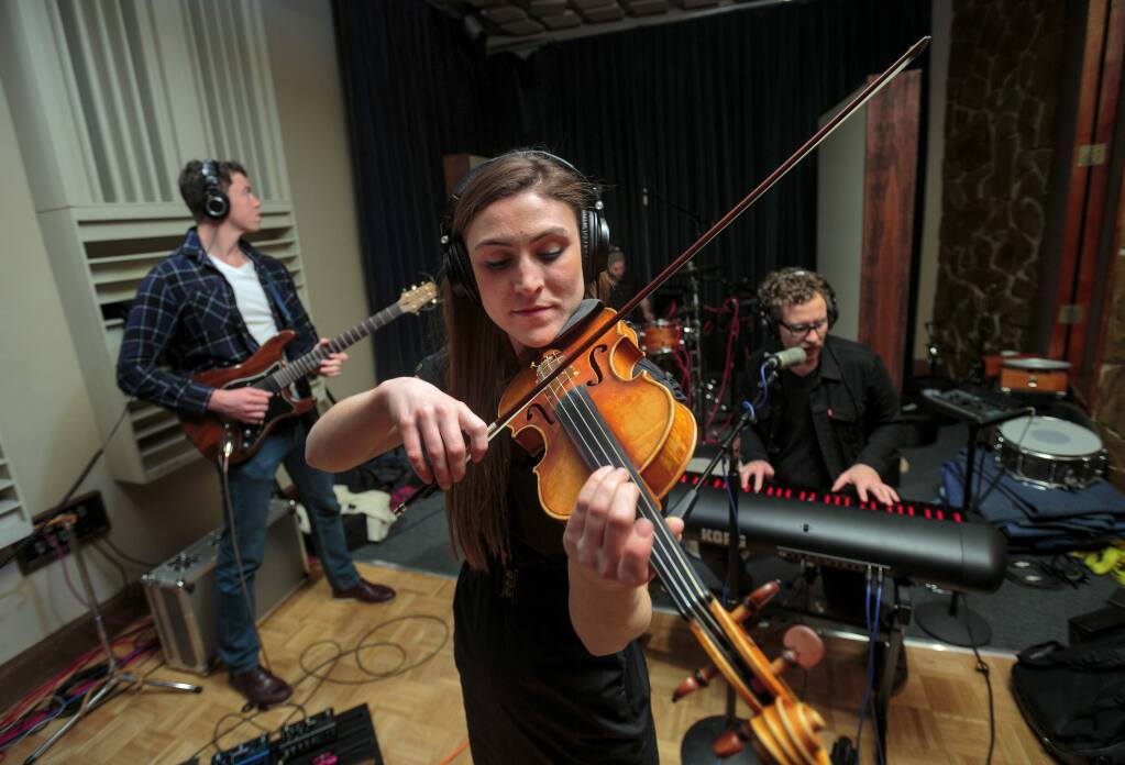 Violinist Ashley Holmberg recording with Brandon Hassur (piano/ vocals), Christian Park (guitar) and Lance Harrington (drums). (CHRIS HARDY)