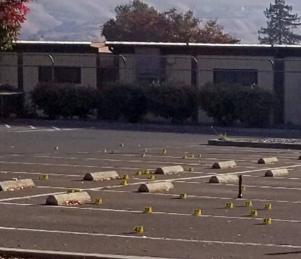 This Saturday, Nov. 23, 2019, photo released by the Union City Police Department shows crime scene evidence markers at the parking lot of the Searles Elementary School in Union City, Calif. Police say a deadly shootings of teenage boys took place early Saturday morning in the parking lot. Authorities say that when officers arrived, they found the boys. (Union City Police Department via AP)