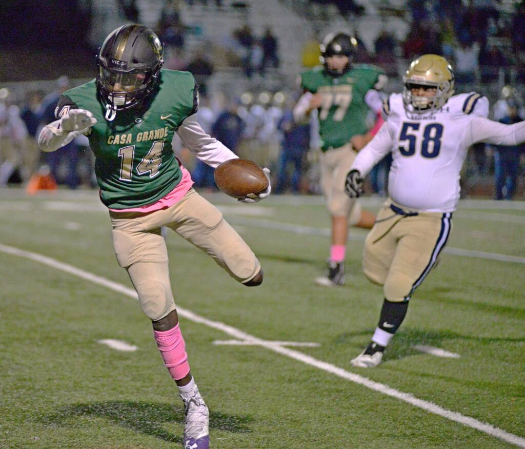 Casa Grande's Dominic Giomi battles for extra yards as a Napa defender tries to strip the ball away in a game won by Napa, 41-18. (SUMNER FOWLER/FOR THE ARGUS-COURIER)
