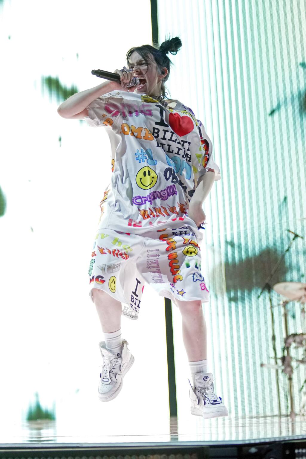 """FILE - This June 9, 2019 file photo shows Billie Eilish performing during the 'When We All Fall Asleep' tour in Chicago. Eilish will be the first recipient of the Apple Music Award for global artist of the year, one of three honors for the pop singer. Apple announced Monday that Eilish's """"When We All Fall Asleep, Where Do We Go?"""" has been named album of the year. Eilish and her brother Finneas will also receive songwriter of the year honors. (Photo by Rob Grabowski/Invision/AP, File)"""