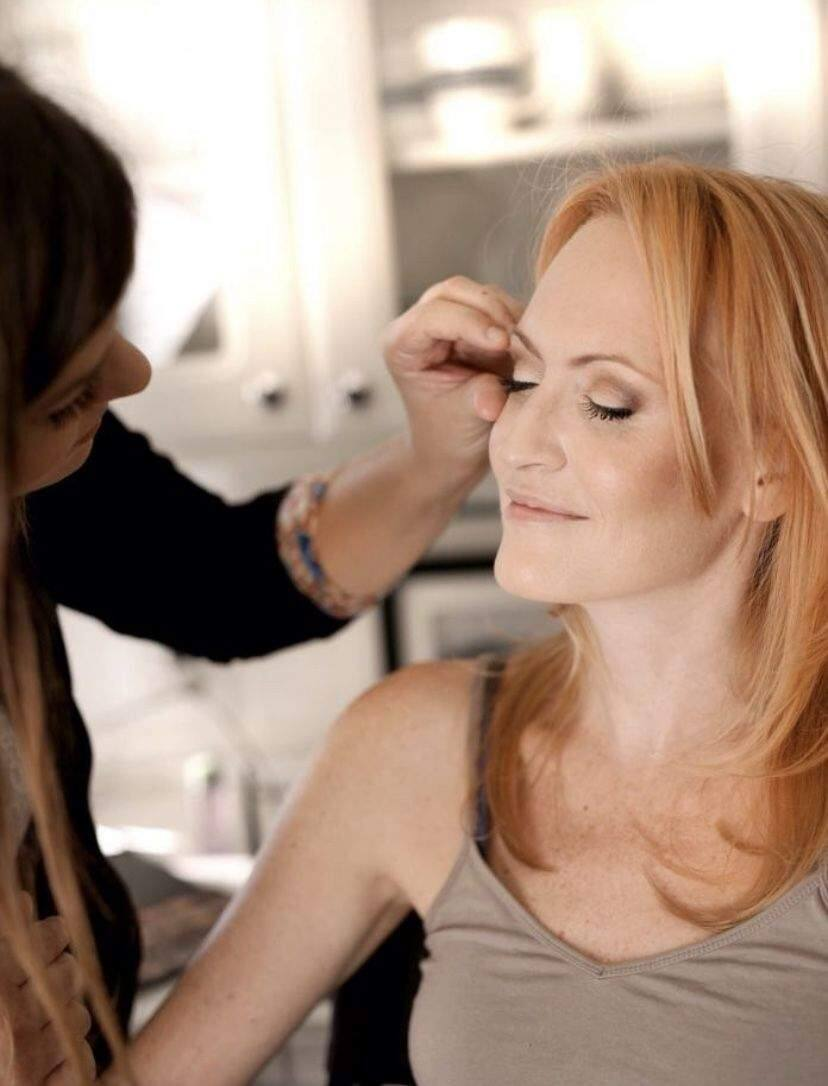 'Here, I'm applying fake eyelashes,' says Bigley. 'While I apply, I share tips and tricks so these looks can be recreated later by the client at home.'