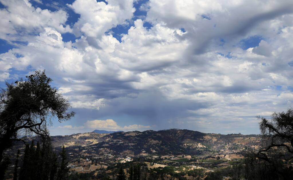 Seen from Fountaingrove looking east, a high based thunderstorm drops rain and a few cloud to cloud lightning flashes over Knights Valley, Wednesday, Sept. 4, 2019. (Kent Porter / The Press Democrat) 2019