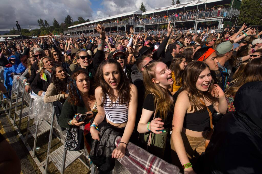 People in the audience dance as they watch Michael Franti, of Michael Franti & Spearhead, during the third day of BottleRock Napa Valley in Napa, California, on Sunday, May 26, 2019. (Photo by Darryl Bush / For The Press Democrat)
