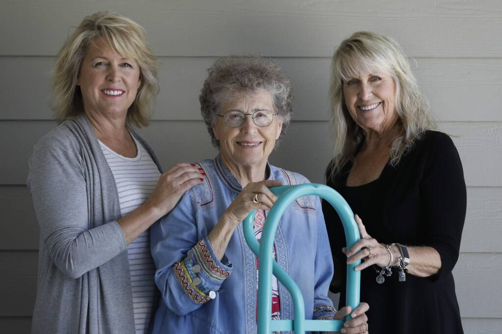 Donna Payne, center, and her daughters Lisa Payne, left, and Belinda Turnbow, right, stand with a hand truck that was recovered from Donna Payne's Fountaingrove home after theTubbs fire and then repainted in a color similar to Tiffany blue. Photo taken on Saturday, June 16, 2018 in Cotati, California . (BETH SCHLANKER/The Press Democrat)