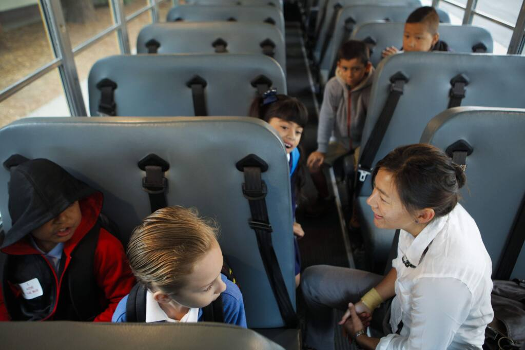 Petaluma, CA, USA. Wednesday, August 17, 2016._ Lauren Anderson, principal of McDowell Elementary rode the school bus with some kids to welcome them to their first day of school. (CRISSY PASCUAL/ARGUS-COURIER STAFF)