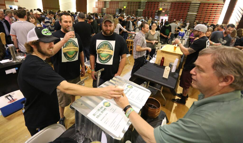 Crista Jeremiason / The Press DemocratMatt Joseph, left, serves beer Pat Power, right, of Petaluma while Nick Gwilliam, second from left and John Ramsey, third from left, watch during the Sonoma County Home Brewer's Competition held at Petaluma's Veterans Memorial Building, Saturday, May 23, 2015. Brewers Joseph, Gwilliam and Ramsey all of Windsor collaborated on the brew. (CRISTA JEREMIASON / The Press Democrat)