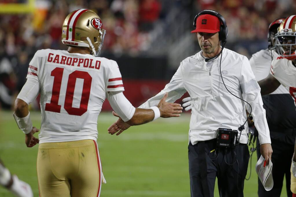 San Francisco 49ers quarterback Jimmy Garoppolo greets head coach Kyle Shanahan after a touchdown against the Arizona Cardinals during the first half, Thursday, Oct. 31, 2019, in Glendale, Ariz. (AP Photo/Rick Scuteri)