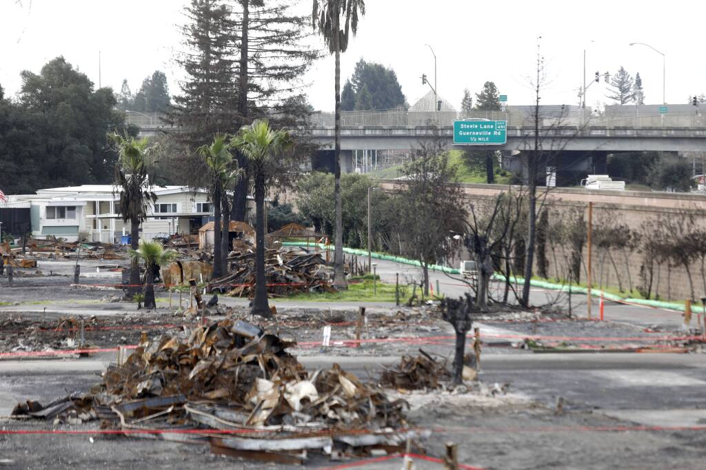 Mobile homes that survived the Tubbs Fire stand uninhabited as cleanup of burned units continues at Journey's End Mobile Home Park on Sunday, February 11, 2018 in Santa Rosa, California . (BETH SCHLANKER/The Press Democrat)