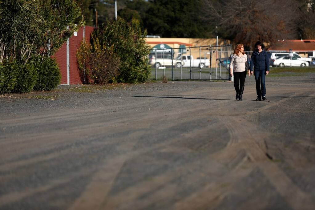 Sonoma County Supervisor Shirlee Zane, left, talks with her staff member Michelle Whitman as they walk through a vacant lot on Fiscal Drive in Santa Rosa where up to 12 tiny homes for homeless people are proposed. (Alvin Jornada / The Press Democrat)