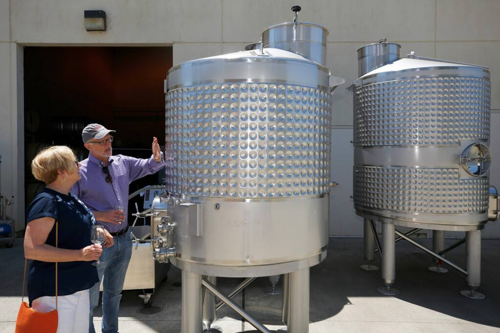 SRJC wine studies program manager Kevin Sea, right, shows SRJC trustee Maggie Fishman the new 900 gallon wine tanks recently acquired by the program through the Strong Workforce state grant, during the Shone Farm Winery Celebration at Santa Rosa Junior College's Shone Farm, in Forestville, California, on Saturday, June 1, 2019. (Alvin Jornada / The Press Democrat)