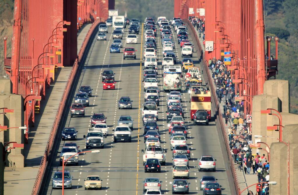Motorists, pedestrians, and cyclists traverse the Golden Gate Bridge on Monday, October 27, 2014 near San Francisco, California . (BETH SCHLANKER/ The Press Democrat)
