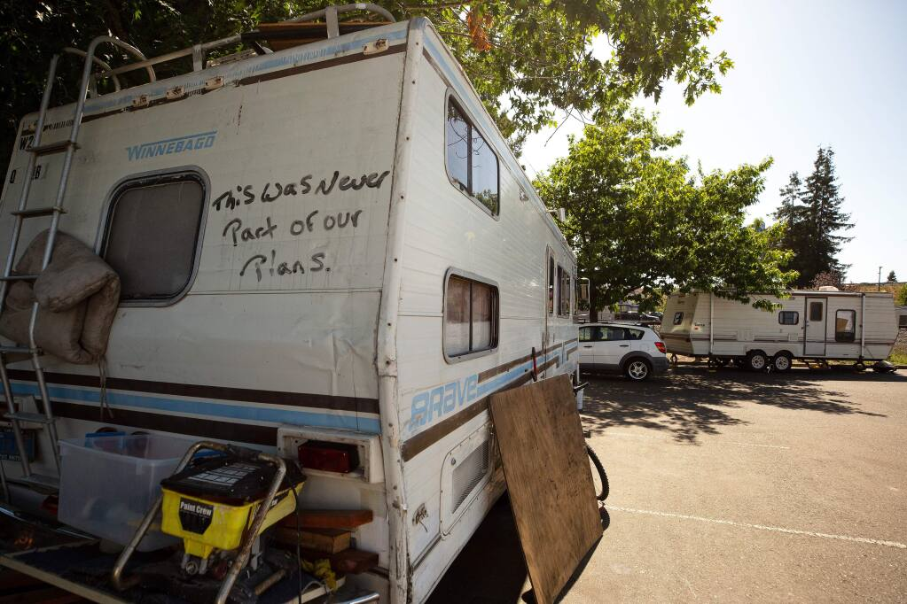 'This was never part of our plans,' is seen written on the back of a homeless person's motor home in a parking lot near the SMART train crossing at Golf Course Drive, in Rohnert Park, California, on Friday, July 19, 2019. (Alvin Jornada / The Press Democrat)