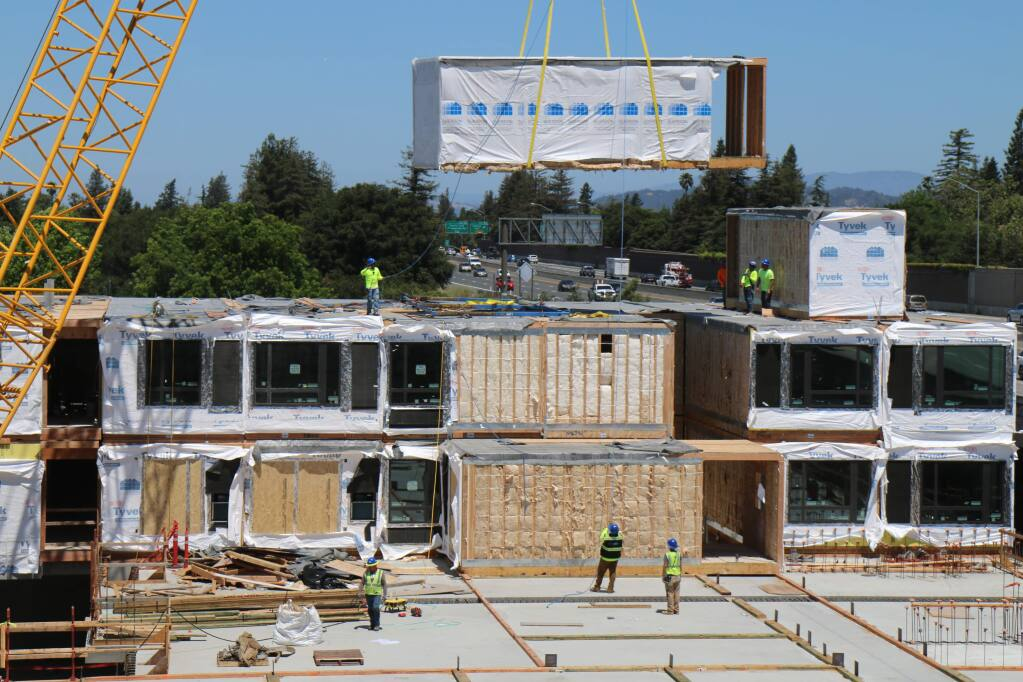 A two-room module built in Idaho is lowered into position on Tuesday, June 18, 2019, at the AC Hotel project next to Highway 101 in downtown Santa Rosa. (Jeff Quackenbush / North Bay Business Journal)