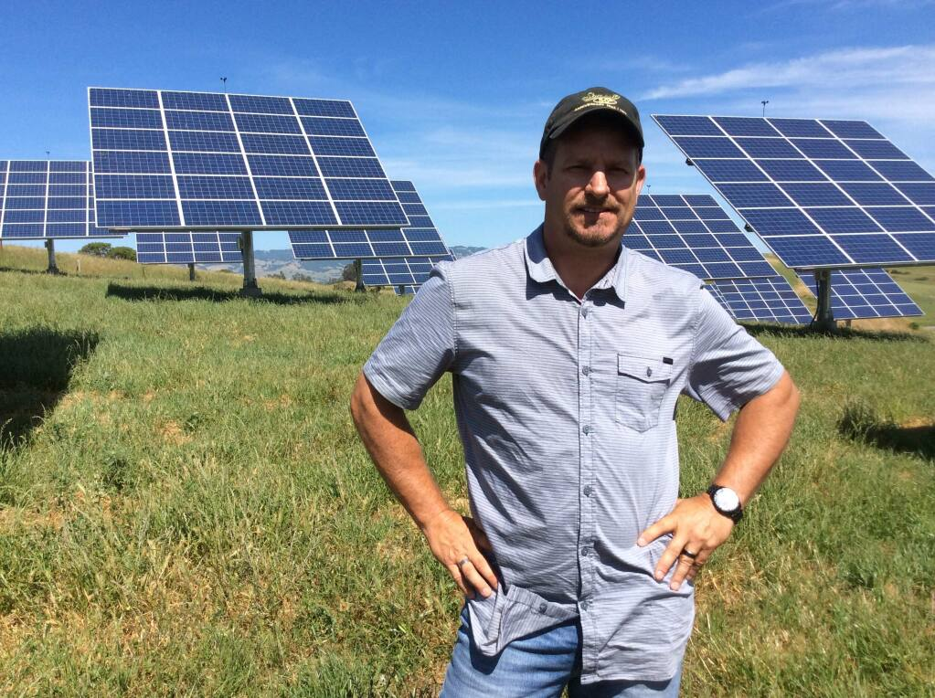 Mark Soiland stands in front of the solar array at Stony Point Quarry near Cotati.