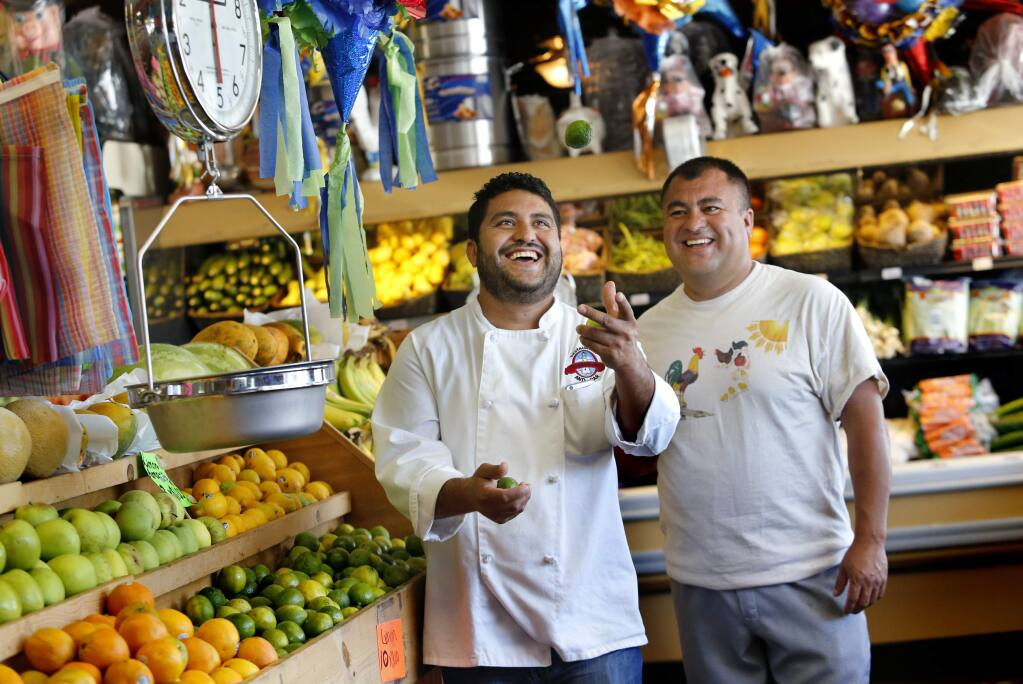 Brothers Pedro, left, and Octavio Diaz at their store Casa del Mole Mercado and Carniceria in Healdsburg, on Monday, August 10, 2015. The brothers also own three Mexican restaurants in Sonoma County.(BETH SCHLANKER/ The Press Democrat)