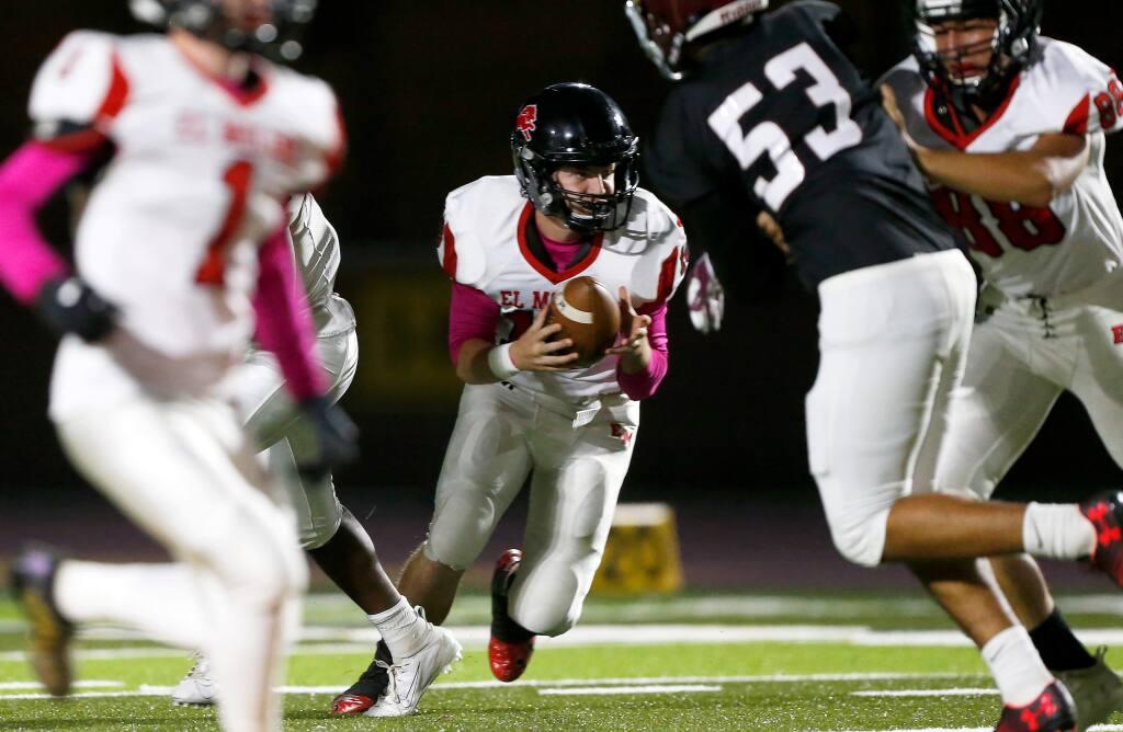 El Molino quarterback Weston Lewis (18) runs on a quarterback sneak during the first half of a varsity football game between El Molino and Piner high schools, in Santa Rosa, California, on Friday, October 11, 2019. (Alvin Jornada / The Press Democrat)