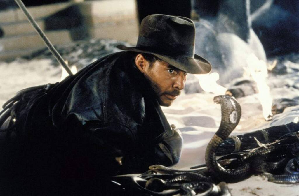 Actor Harrison Ford comes face-to-face with a cobra in a scene from the 1981 Indiana Jones adventure 'Raiders of the Lost Ark.' (Associated Press)