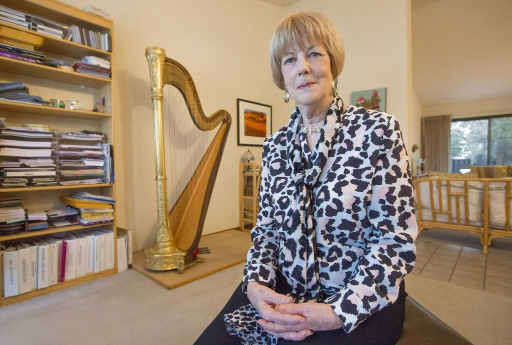 A plucky spirit: Georgia Kelly rode her harp to New Age notoriety in the 1970s; today she finds peace in Praxis. (Photo by Robbi Pengelly/Index-Tribune)