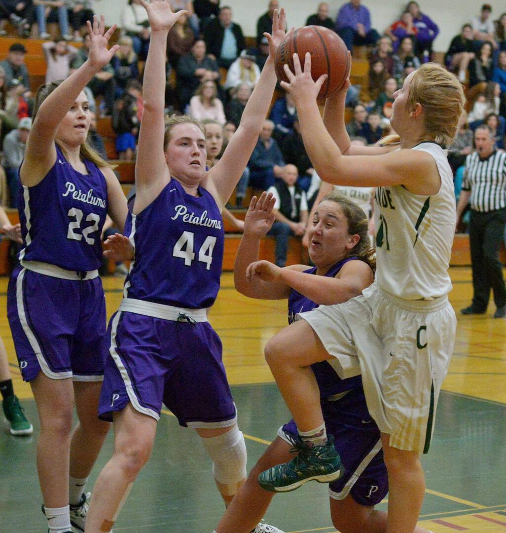 SUMNER FOWLER/FOR THE ARGUS-COURIERCasa Grande's Trinity Merwin gets a shot up over the determined guard of Petaluma's Mallory O'Keefe, Rose Nevin (44) and Bella Weinberg (22).