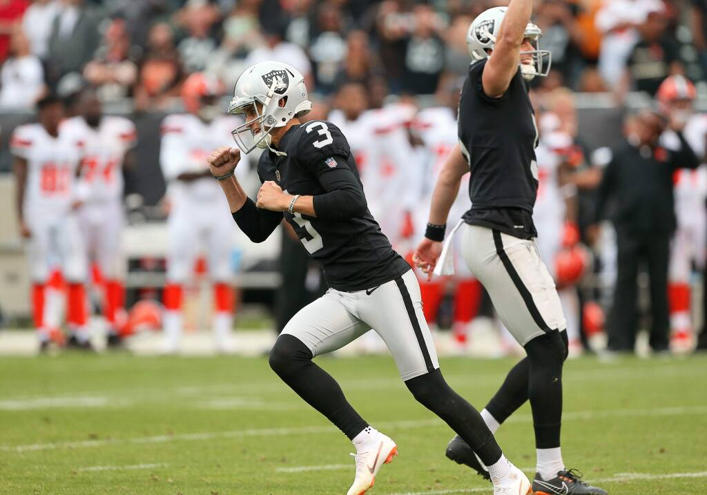 Oakland Raiders kicker Matt McCrane celebrates hitting teh field goal to defeat the Cleveland Browns in overtime, during their game in Oakland on Sunday, September 30, 2018. Raiders beat the Browns.(Christopher Chung/ The Press Democrat)