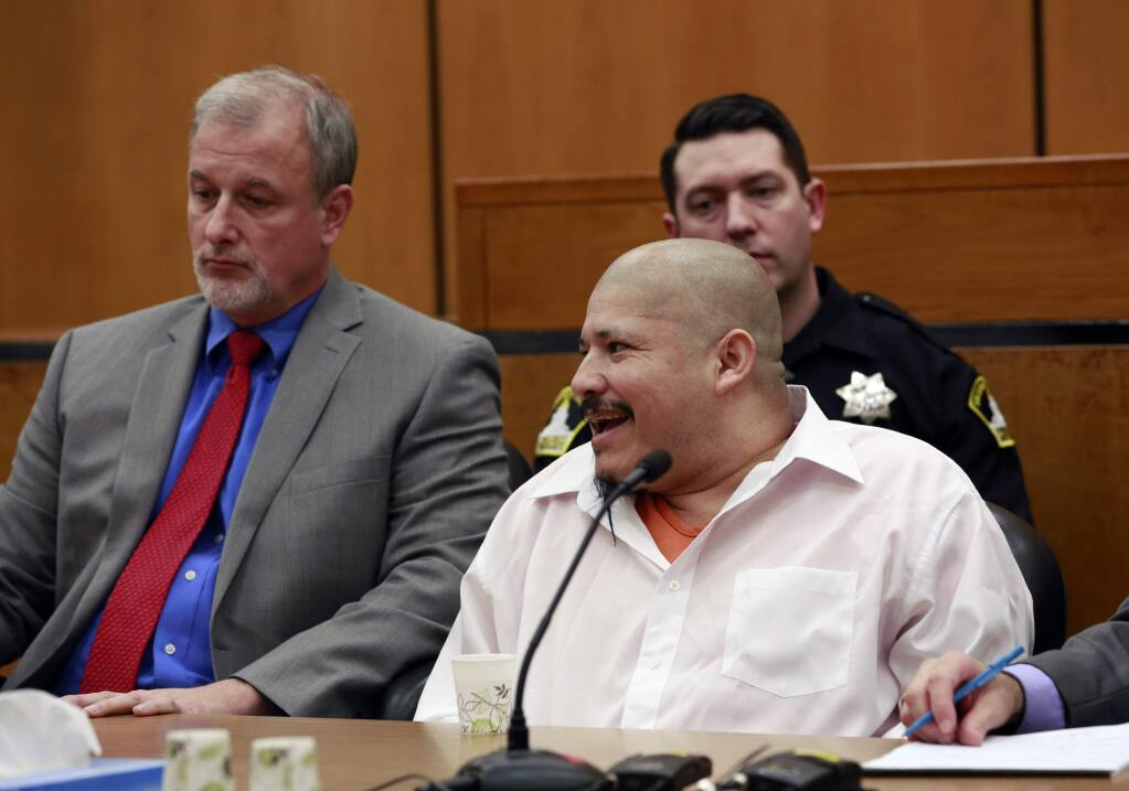 FILE - In this Feb. 9, 2018 file photo, Luis Bracamontes smiles at the courtroom audience as the verdict was read in the killing of two law enforcement officers, in Sacramento Superior Court in Sacramento, Calif. Jurors have found a Utah woman guilty of murder for aiding her husband, Bracamontes, as he killed two Northern California sheriff's deputies in 2014. They convicted Janelle Monroy Thursday, Feb. 15, 2018, of 10 charges including murder, attempted murder and carjacking. They rejected her argument that Bracamontes would have killed her if she didn't help him. (AP Photo/Rich Pedroncelli, File)