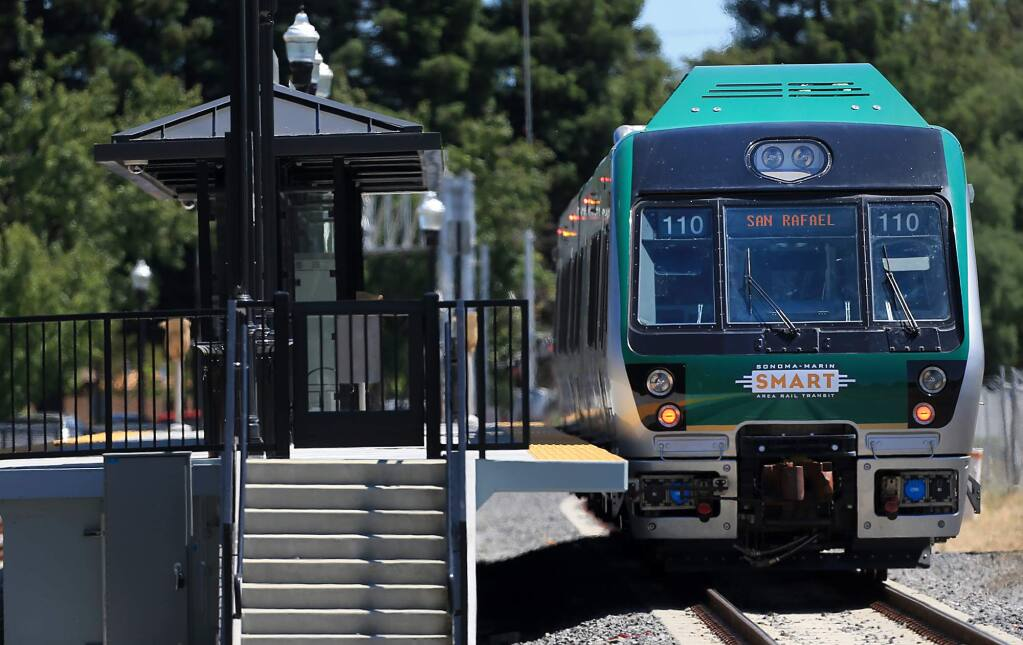 A SMART train heads for San Rafael after stopping at the Railroad Square station in Santa Rosa in June. (KENT PORTER/ PD FILE, 2017)