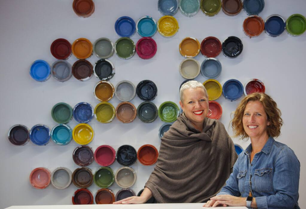 Keller Street CoWork's Christine Walker, the Brand Ambassador and Danielle Stroble, the Community Director, pose for a portrait inside the new collaborative work space. (CRISSY PASCUAL/ARGUS-COURIER STAFF)