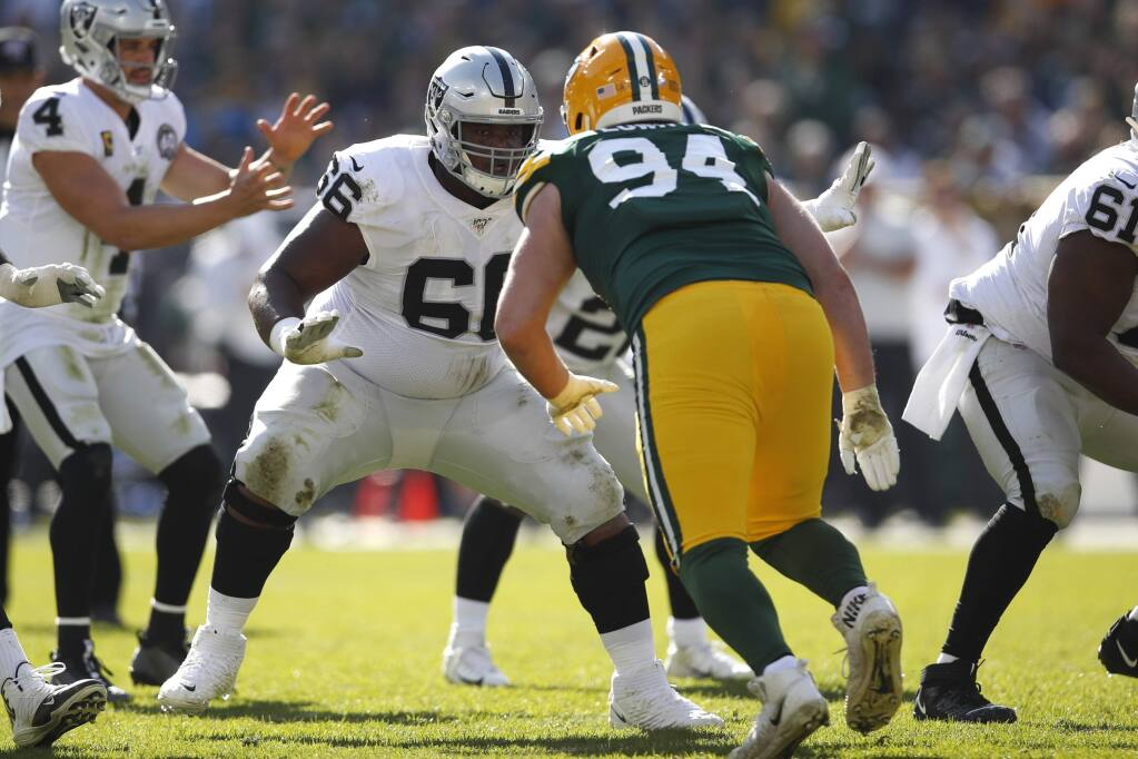 Oakland Raiders center Rodney Hudson (61) sets to block Green Bay Packers defensive end Dean Lowry (94) Sunday, Oct. 20, 2019, in Green Bay, Wis. The Packers won the game 42-24. (Jeff Haynes/AP Images for Panini)
