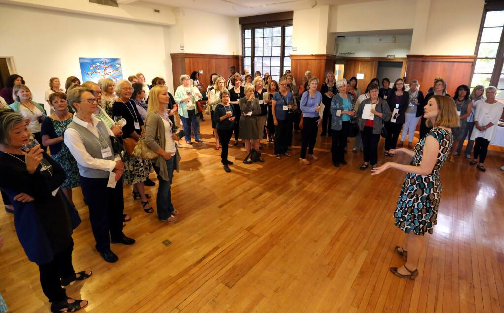 Melissa Kelley, founding member, right, speaks to the attendees of the Impact 100 Redwood Circle Kickoff Event hosted by the Community Foundation Sonoma County and held at the Museums of Sonoma County in Santa Rosa, Wednesday, June 10, 2015. (CRISTA JEREMIASON / The Press Democrat)
